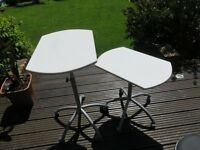 Two tables 60cm x 40cm with lockable wheels and adjustable heights, perfect condition.