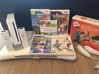Nintendo wii with balance board and games