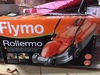 CORDLESS BLACK+DECKER TRIMMER AND FLYMO ROLLERMO SPARE OR REPAIR