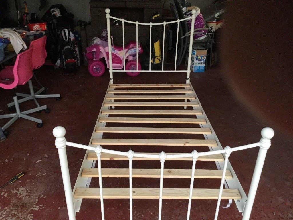 Children's single bed - metal framework with wooden slot centre
