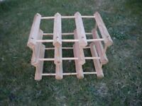 A 6 BOTTLE WINE RACK IN PINE