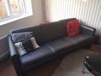 2x 3 seater black leather sofa