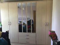 Large triple wardrobe unit