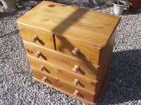 Pine chest of drawers with 2 small drawers and 3 larger.