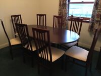 *used twice like new* Pristine Mahogany extending dining table with 8 chairs