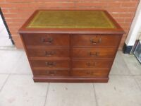 A Yew Wood Green Leather Inlay Four Draw Filing Cabinet