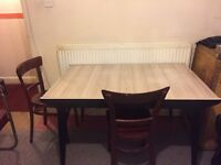 Kitchen table with assorted chairs