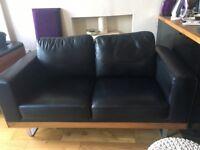 Dwell black leather & wood veneer 2/3 seater sofa and swivel armchair