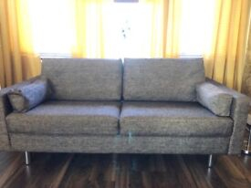 2 stunning sofas and matching tub chair very modern new condition