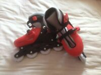 Adjustable In line Skates red & Black - sizes 5 - 7 Excellent condition