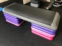 Exercise step with risers