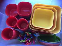 Selection plastic plates, cups, bowls and cutlery