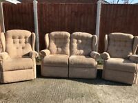 Three piece suite. Beige. Wing back. Very good condition. Sofa and armchairs