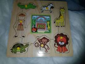Wooden jigsaw and book. Almost new