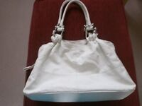 White hand bag with novelty strap fittings