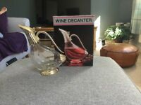 Glass and Silver Red Wine decanter, excellent condition, hardly used, box still in good condition.