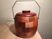 Vintage pot decorated with a wide range of different woods