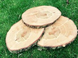 Rustic wedding log slices centre pieces decorations natural tree
