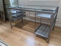 Stylish glass desk with metal drawers