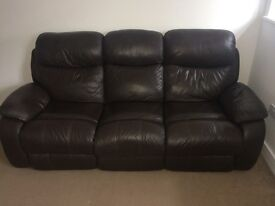 Reclining brown leather sofa and chair
