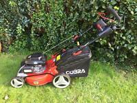 """Cobra 18"""" self propelled 4 in 1 lawn mower,Honda powered."""