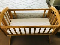 Wooden crib with mattress