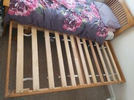 Single wooden bed with trundle