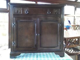 For Sale ......Small sideboard. Dark wood.