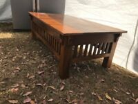 Stylish solid dark wood coffee table originally bought from John Lewis. Excellent condition