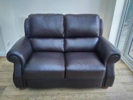Excellent condition two seater dark brown leather sofa.
