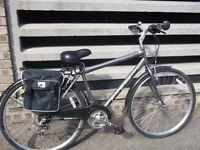 hybrid bike with host of extras inc. stand rear rack and panniers .little used