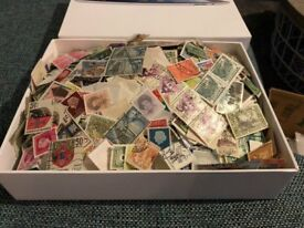 Ipad box full of world stamps - unsorted and unchecked - off paper