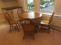 Round wooden table with 4 wooden chairs