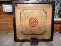 lovely quality carrom board (66 cms by 66 cms) with playing coins,very good carrom board,only £35...