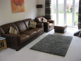 Full leather three seater sofa and chair with foot stool.