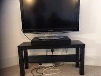 Black tv stand with shelf storage