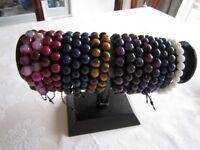 17 Mixed chakra bracelets on elastic stretch base. Genuine semi precious stones. new, unused.