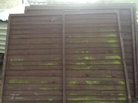 Used waney lap fence panels