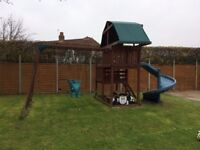Adventure Playcentre - Wooden playcentre with monkey bars, cargo net, spiral slide, and swings