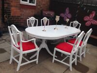 Bespoke dining table and six red crushed velvet chairs