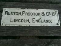 ANTIQUE CAST IRON SIGN, RUSTON PROCTOR LINCOLN.