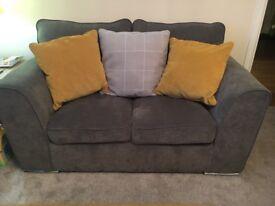 Small grey 2 seater fabric sofa