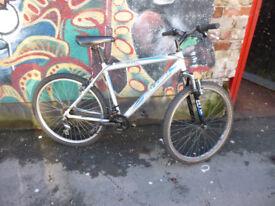 Raleigh mountain bike 26 inch wheels, 21 gears, V brakes, 19 inch aluminium frame, suspension forks.