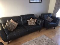 Black leather suite - 3 seater sofa 2 chairs and footstool. Some wear but still nice looking.