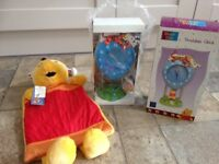 Brand new Winnie the Pooh clock and hot water bottle