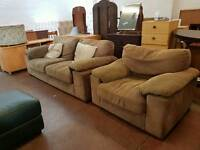Modern brown fabric two seater and armchair sofa suite