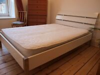 Ikea double bed with sprung mattress, white headboard, all parts included, stainless steel legs