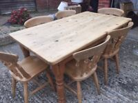 Large wooden rectangular table with six matching chairs in good condition.