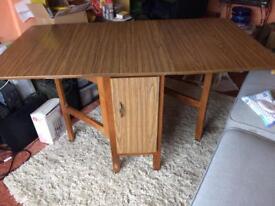 Foldaway table with cupboard