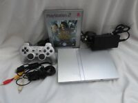 Silver Slim Playstation 2, leads , controller and Lord of the Rings game